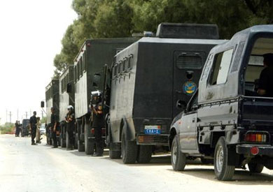 http://www.shorouknews.com/uploadedimages/Sections/Egypt/Accidents/original/Security-forces-in-Kerdasa21.jpg