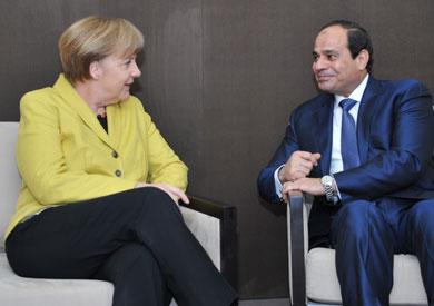 الرئيس السيسي وميركل في لقاء سابق- أرشيفية