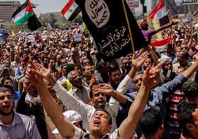 متظاهرون يرفعون أعلام الجهاد الإسلامي - ارشيفية