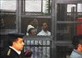 أحمد ماهر وأحمد دومة داخل قفص الاتهام في جلسة سابقة
