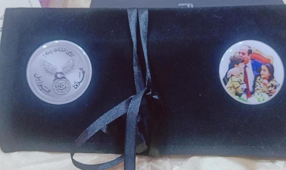 """من هدايا الرئيس لشهداء كورونا - حاملة شعار """"شهداؤنا البواسل"""""""