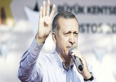 لرئيس التركي رجب طيب أردوغان يلوح بإشارة «رابعة»-ارشيفية