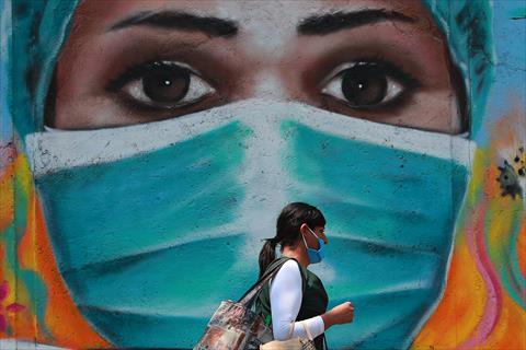 دعاية تشجع على ارتداء الكمامة بالمكسيك - د.ب.ا