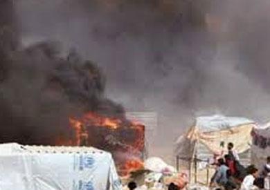 اضرام النار من المهاجرين بالمخيم - ارشيفية