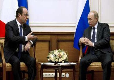 الرئيس فرنسوا هولاند مع نظيره الروسي فلاديمير بوتين
